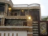 بيت بمساحة 216 م بتصميم فخم وديكورات رائعة - صورة مصغرة